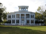 The Greek Revival anti-bellum information center at the Montgomery Sang Boat next to the Tom Bevill Lock